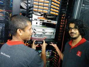Dhiraagu team installing the RIPE Atlas Anchor in their NOC