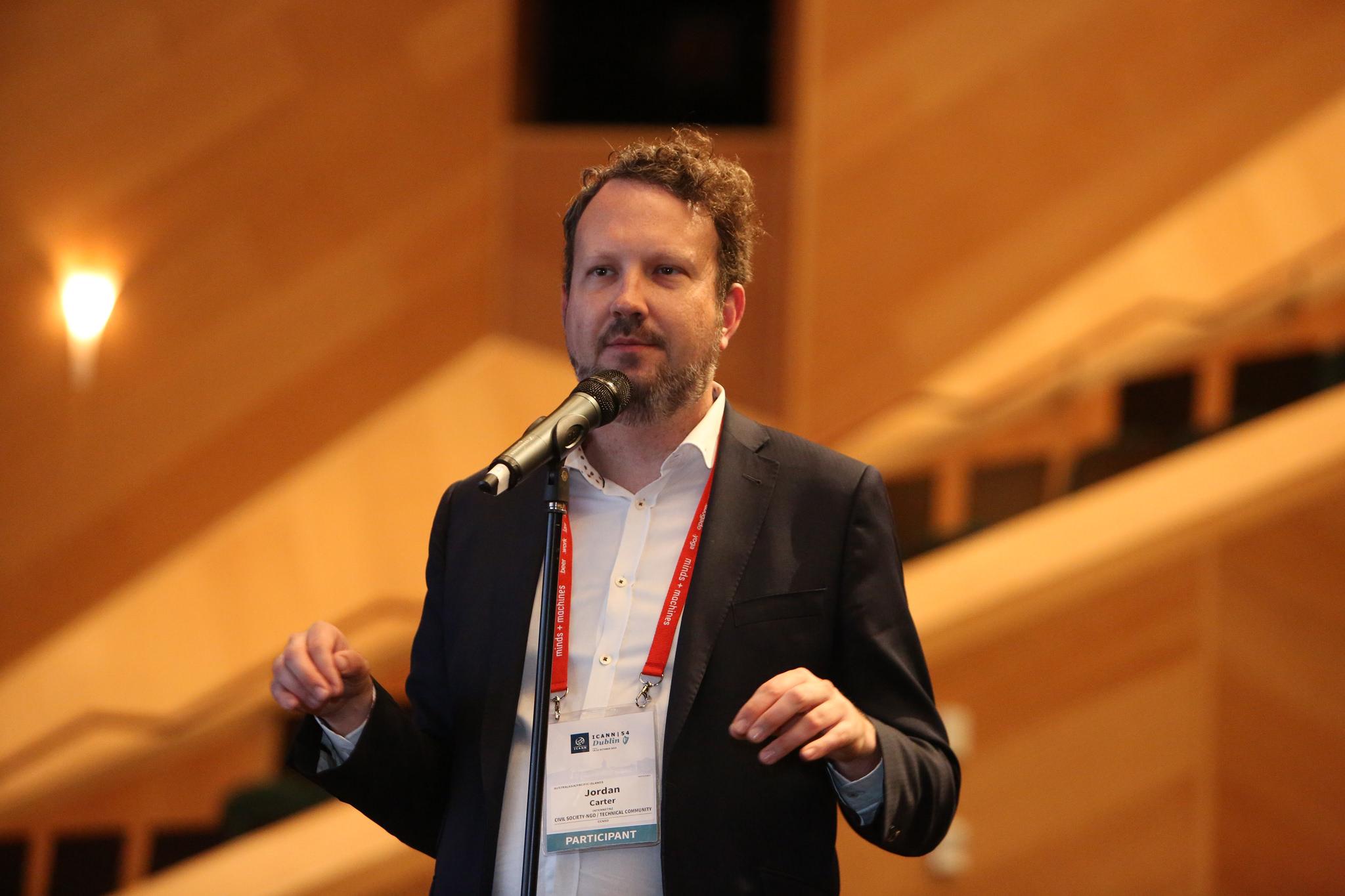 "Internet NZ's Jordan Carter makes a point at ICANN 54. Image credit: <a href=""https://www.flickr.com/photos/icann/"">ICANN</a>"