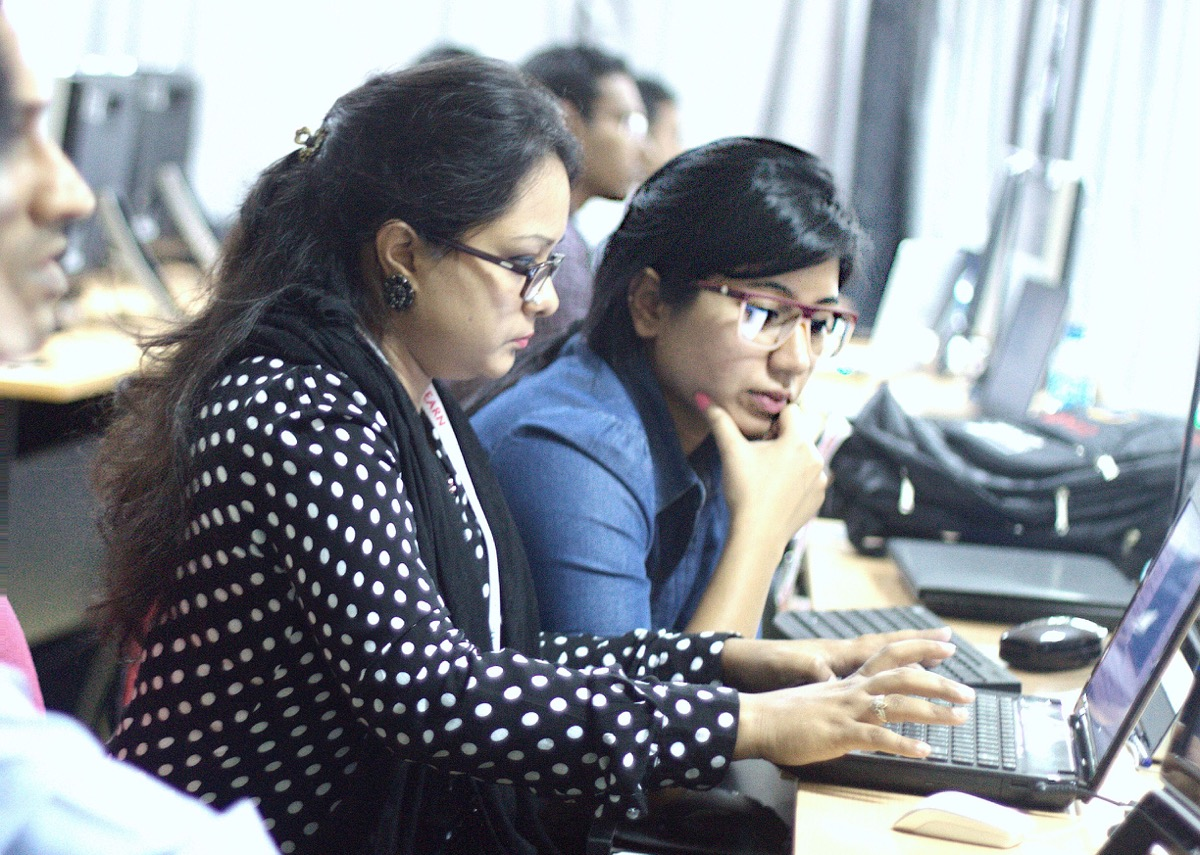Sadia Safwat (left) and Shaila Sharmin (right) working together at the SANOG 25 workshop. Sharmin says these conferences and workshops are important for career development.