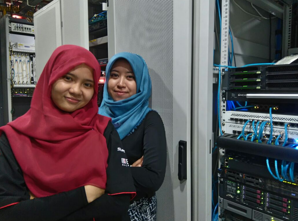 Irma Gustina (front) and Anggun Fuji Lestari (back) work for PT Mora Telematika Indonesia as NOC Core Engineers