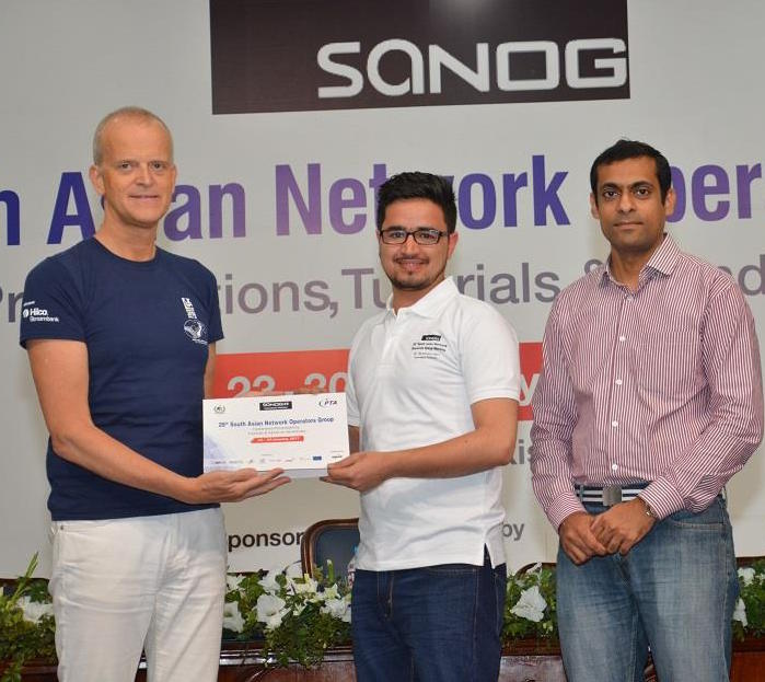 Accepting my certificate of completion for DNS/DNSSEC workshop from Philip Smith (left) and Aftab Siddiqui (right).
