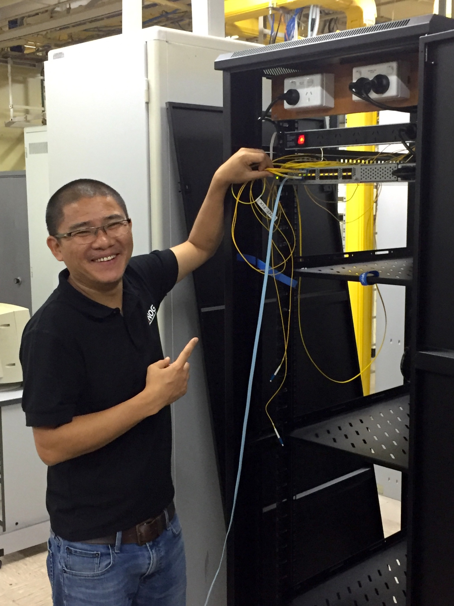 Tashi Phuntsho (APNIC) helped install the switch.