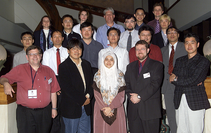 "Azrina (centre) With the Asia Pacific CERT (<a href=""https://www.apcert.org"" target=""_blank"">APCERT</a>) founding members during AusCERT Conference 2002, Brisbane, Australia."