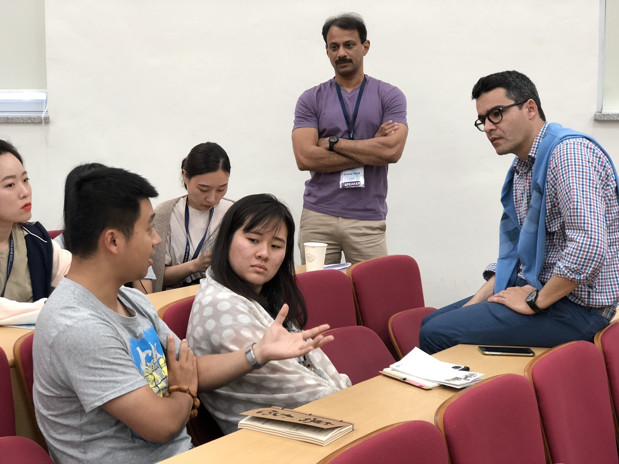 APNIC's Pablo Hinojosa (right) and Sunny Chendi (centre) discussing APNIC's role in the Internet ecosystem with the next generation of technical community leaders.
