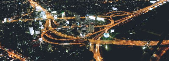 header image: aerial view of highway system at night