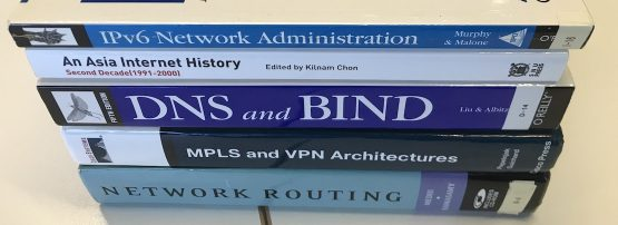 Networking books stacked