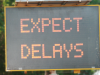 Street safety sign showing 'Expect Delays'