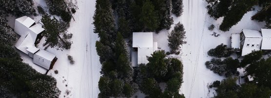 Aerial photo of rural snow-covered houses by Tomas Anunziata